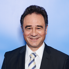 Dr. Karim Taga